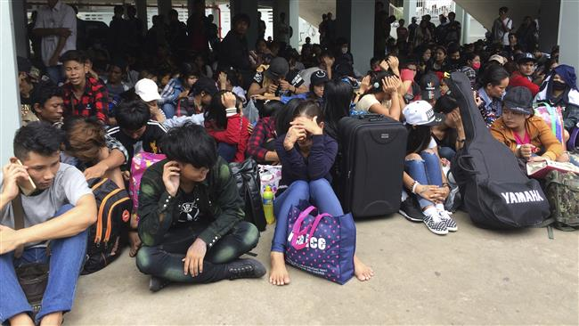 Tens of thousands of migrants flee as Thailand imposes new labor rules