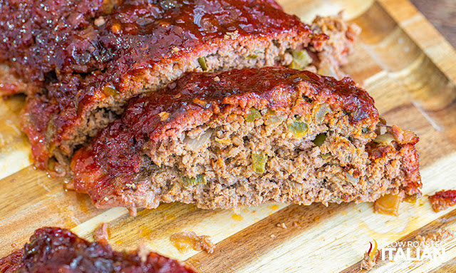 smoked meatloaf sliced on a cutting board