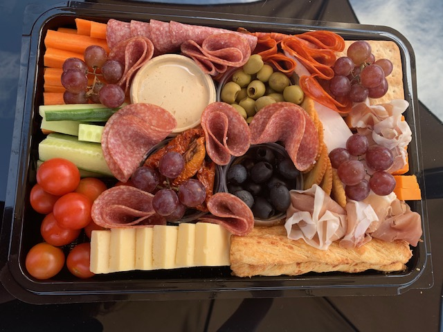 Platter containing meats, cheeses, crudites and antipasti