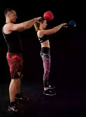 two person performing russian kettlebell