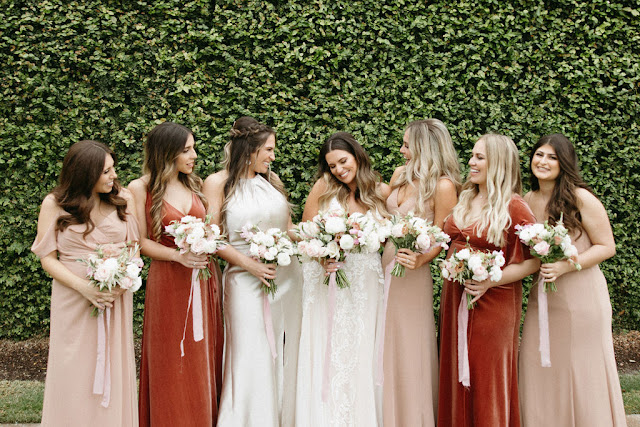 bride with bridesmaids in burgundy gold colors