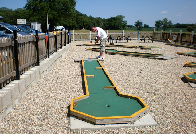 Playing on the Minigolf course at Blake End Craft Centre near Braintree