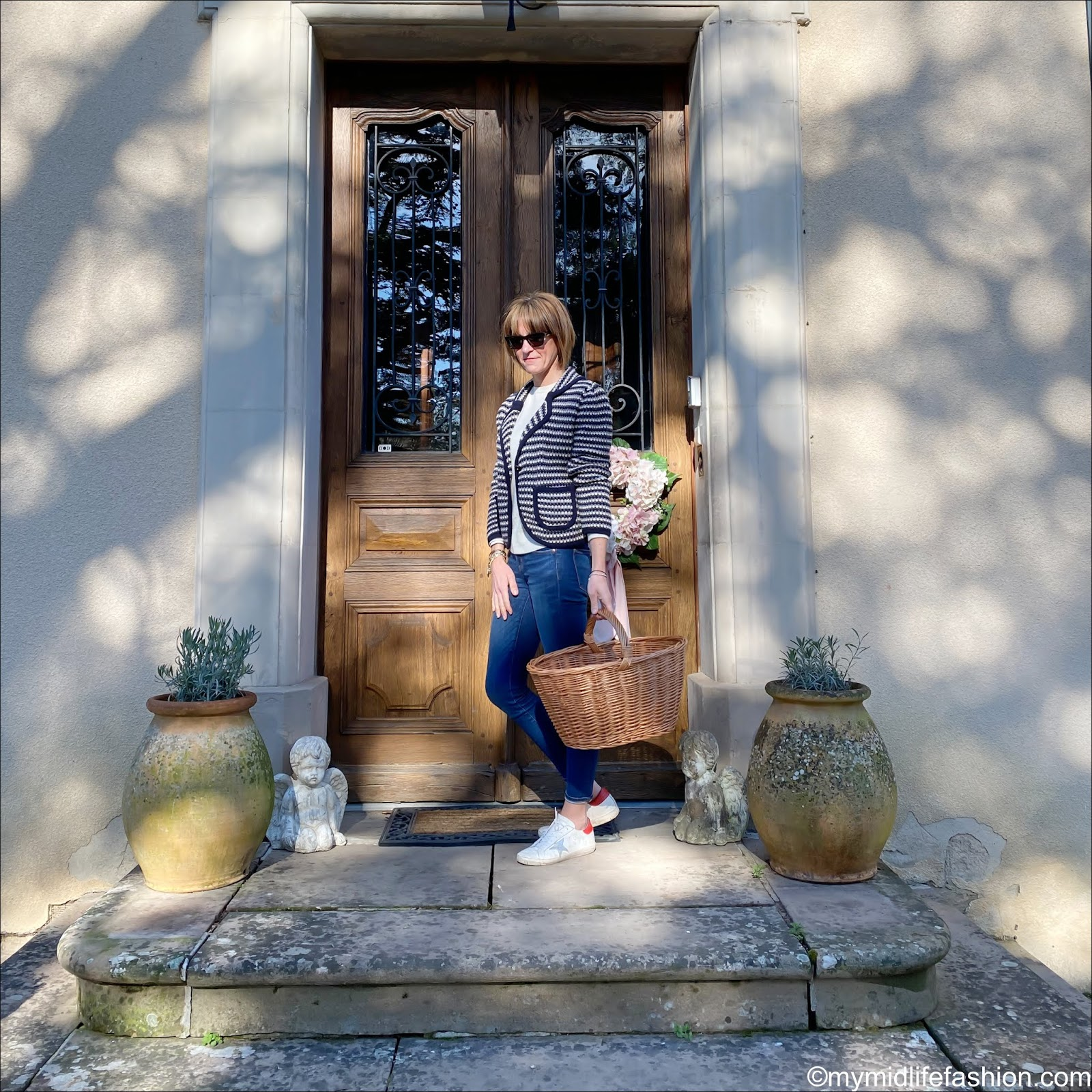 my midlife fashion, see by Chloe knitted jacket, marks and Spencer pure cashmere round neck jumper, traditional wicker shopping basket, j crew 8 inch toothpick jeans, golden goose superstar low top leather trainers