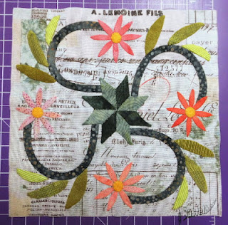 flower and stems appliqued on a quilt block