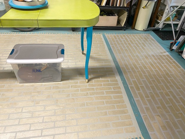 Metallic brick stenciled floor