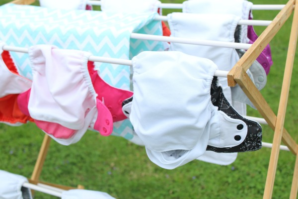 cloth diapers vs disposable diapers- real answers from real moms- what should you know before you decide? Survey answers- Bumgenius diapers drying in the sun