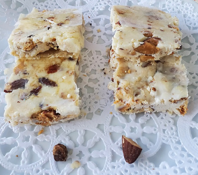 this is torrone candy made in the microwave with roasted almonds in a nougat and wafer paper