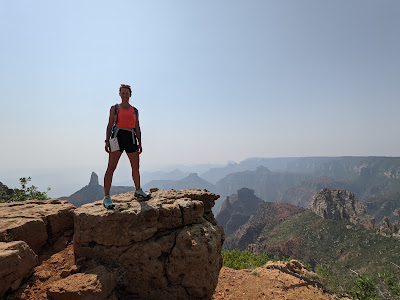 Fran poses with the Grand Canyon behind her