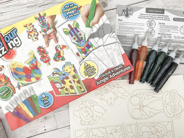 ColourMazing box and pens and colour sheets at the side