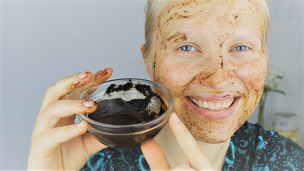 girl exfoliates her face with coffee