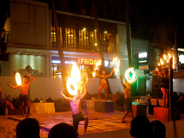 Fire dancers performing on White Beach, Boracay, Philippines