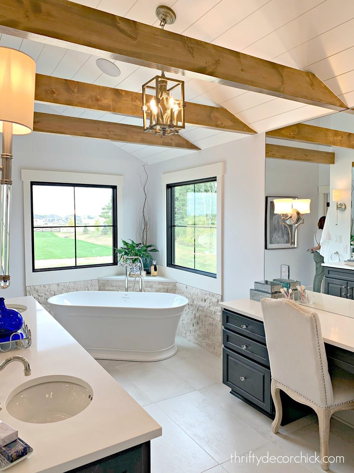 Wood beams in master bathroom dark cabinets