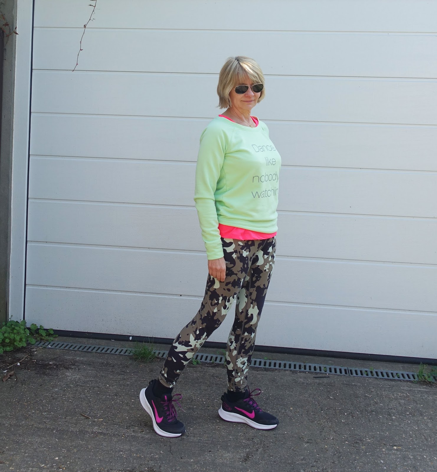 For the April Style Not Age Challenge Gail Hanlon from Is This Mutton is sporting Comfy Casuals - light green sweatshirt and camo leggings