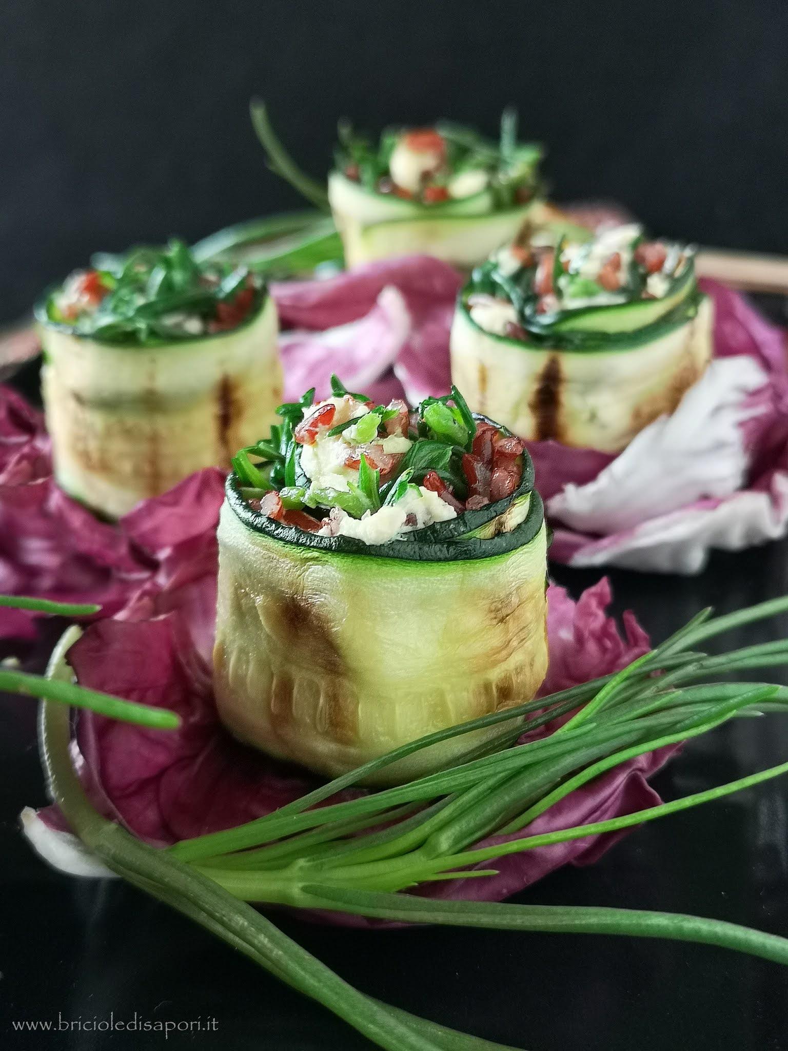 rotolini di zucchine con agretti riso rosso e robiola