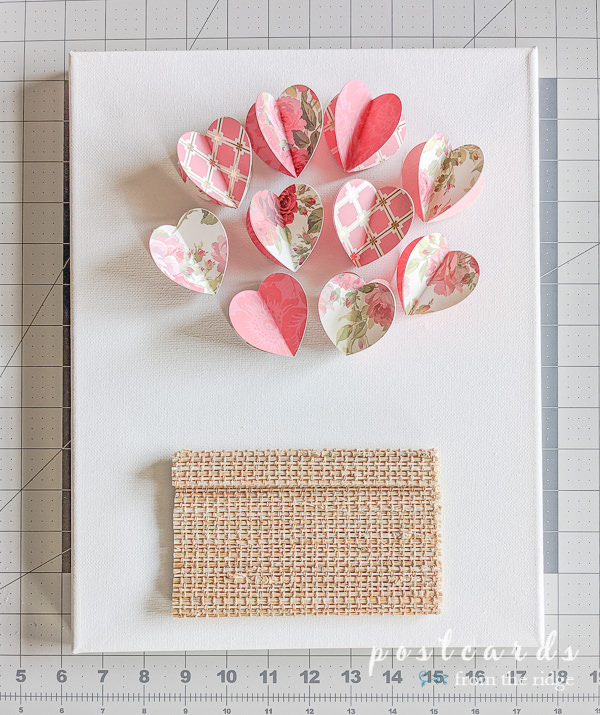 3-d paper hearts on a white canvas