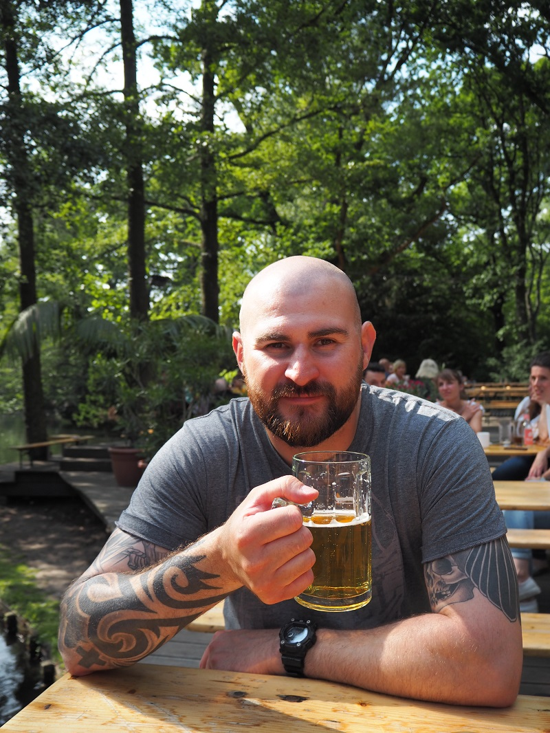 Gordon drinking beer at Cafe am neuen see beer garden