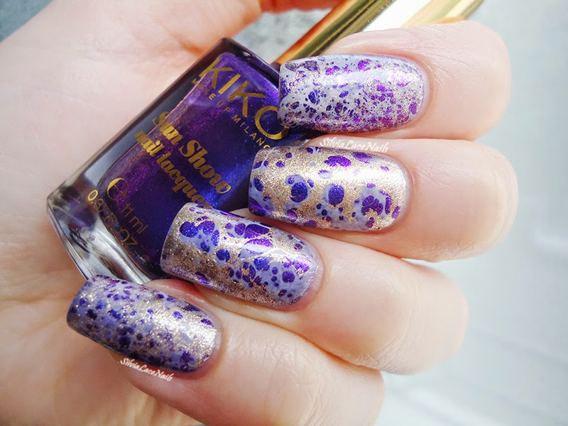 Purple and gold water spotted nail art