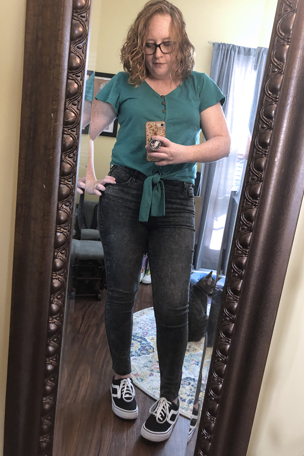 black jeans teal knotted top
