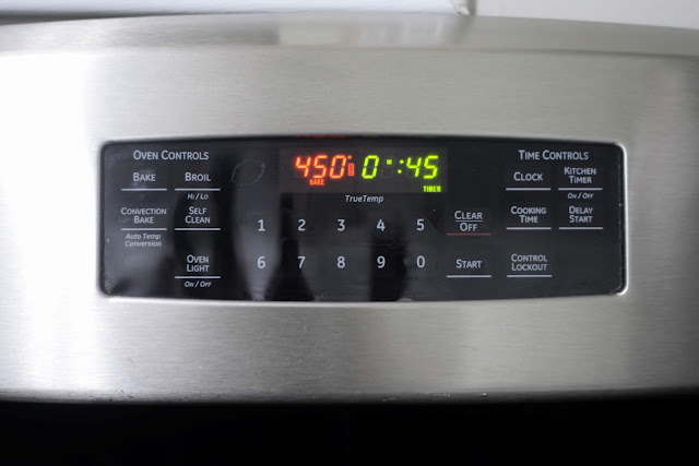 The temperature and timer set on the oven.