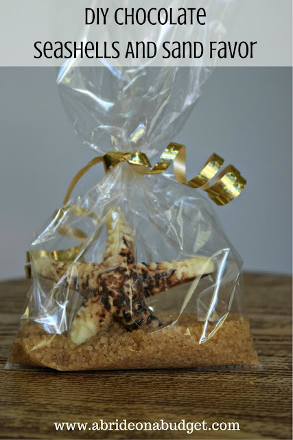 If you need a favor idea for your beach wedding, check out the DIY Chocolate Seashell And Sand Favors from www.abrideonabudget.com.