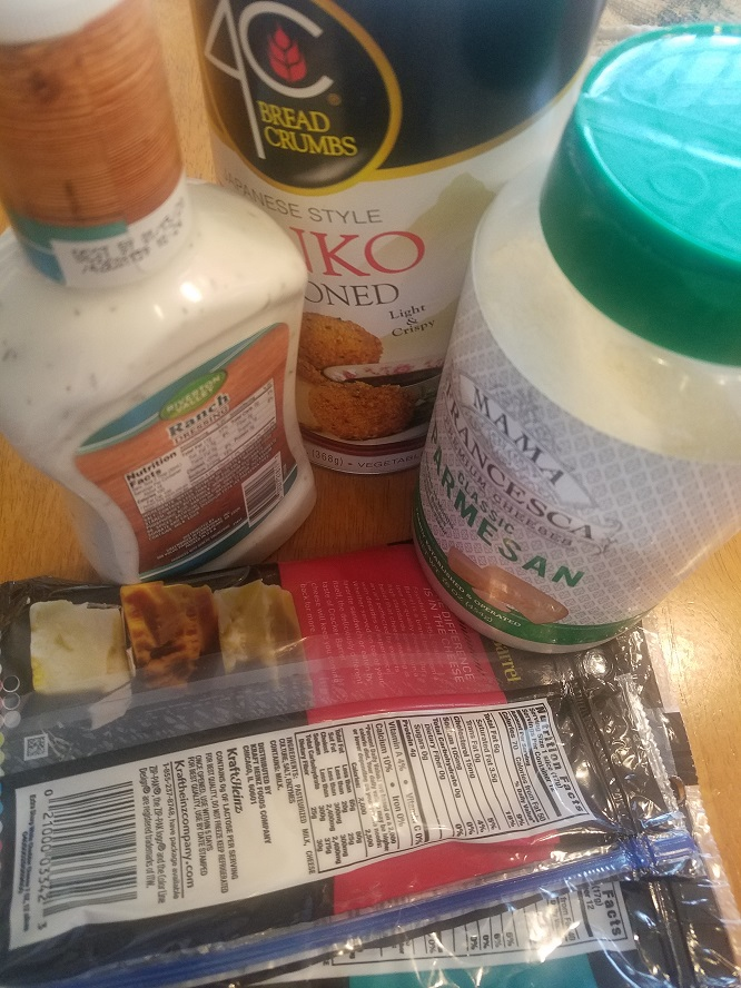 these are the ingredients in the longhorn recipe for crusted parmesan chicken ranch dressing, parmesan cheese, cheddar and provolone