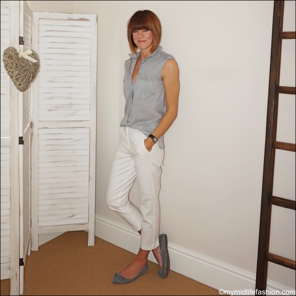 my midlife fashion, Isabel Marant cotton sleeveless ruffle top, marks and Spencer Mia slim cropped trousers, j crew tassel suede pointed flats