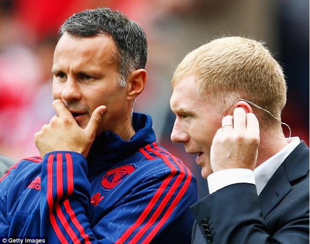 Manejer baru Wales Ryan Giggs ingin rekrut rekannya Paul Scholes dalam staf nya