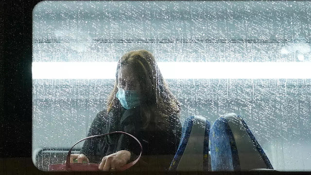 A passenger wearing a mask rides on an almost empty train at morning commute time in Sydney, Australia on June 28 - Photo: REUTERS