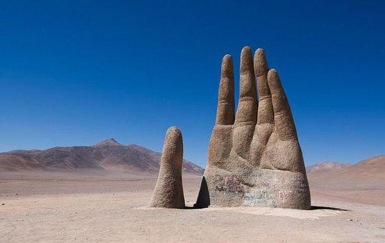 A photo of Mano del Desierto (Hand of the Desert)scuplture, in Atacama Desert, Chile