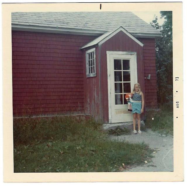 Me outside one room school house 1973