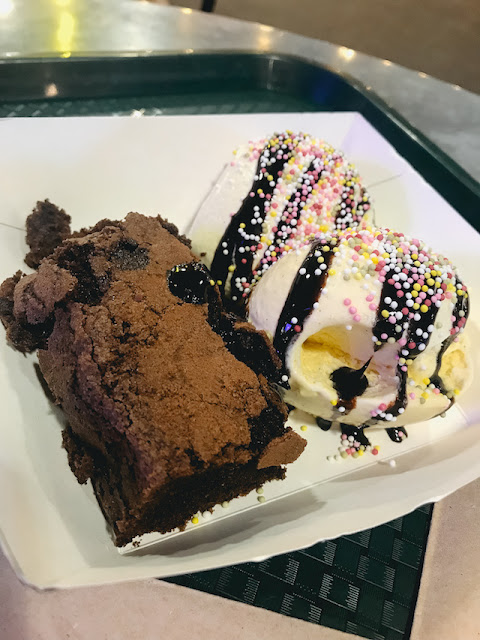 Nans Kitchen brownie and ice-cream with chocolate sauce and sprinkles