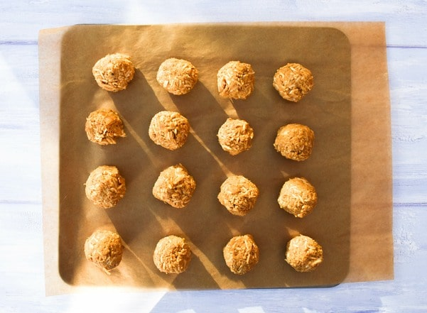 uncooked vegan meatballs on a baking sheet