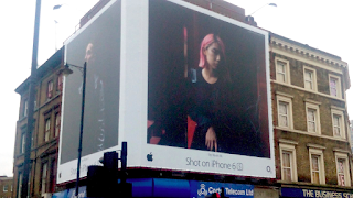 Apple shot on iphone outdoor ad on building
