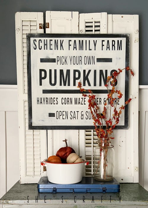 Pumpkin Sign on a side table.