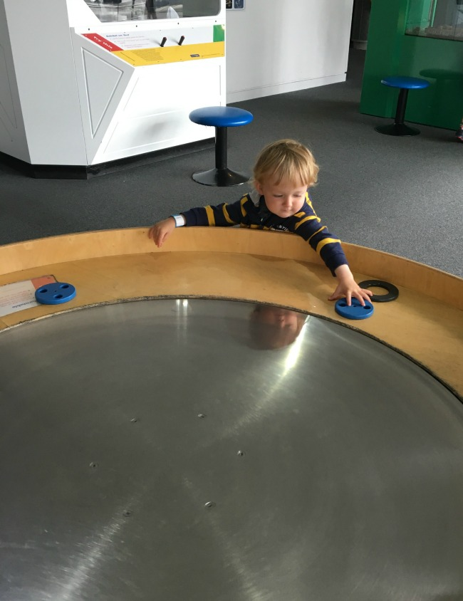 image-of toddler-playing-with-metal-rings-next-to-a-table