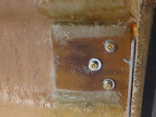 bolts through a fiberglass trailer wall