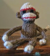 http://www.ravelry.com/patterns/library/tiny-sock-monkey