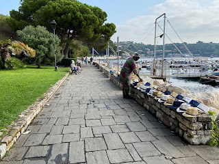 A vendor sets up along the lungomare in Portovenere