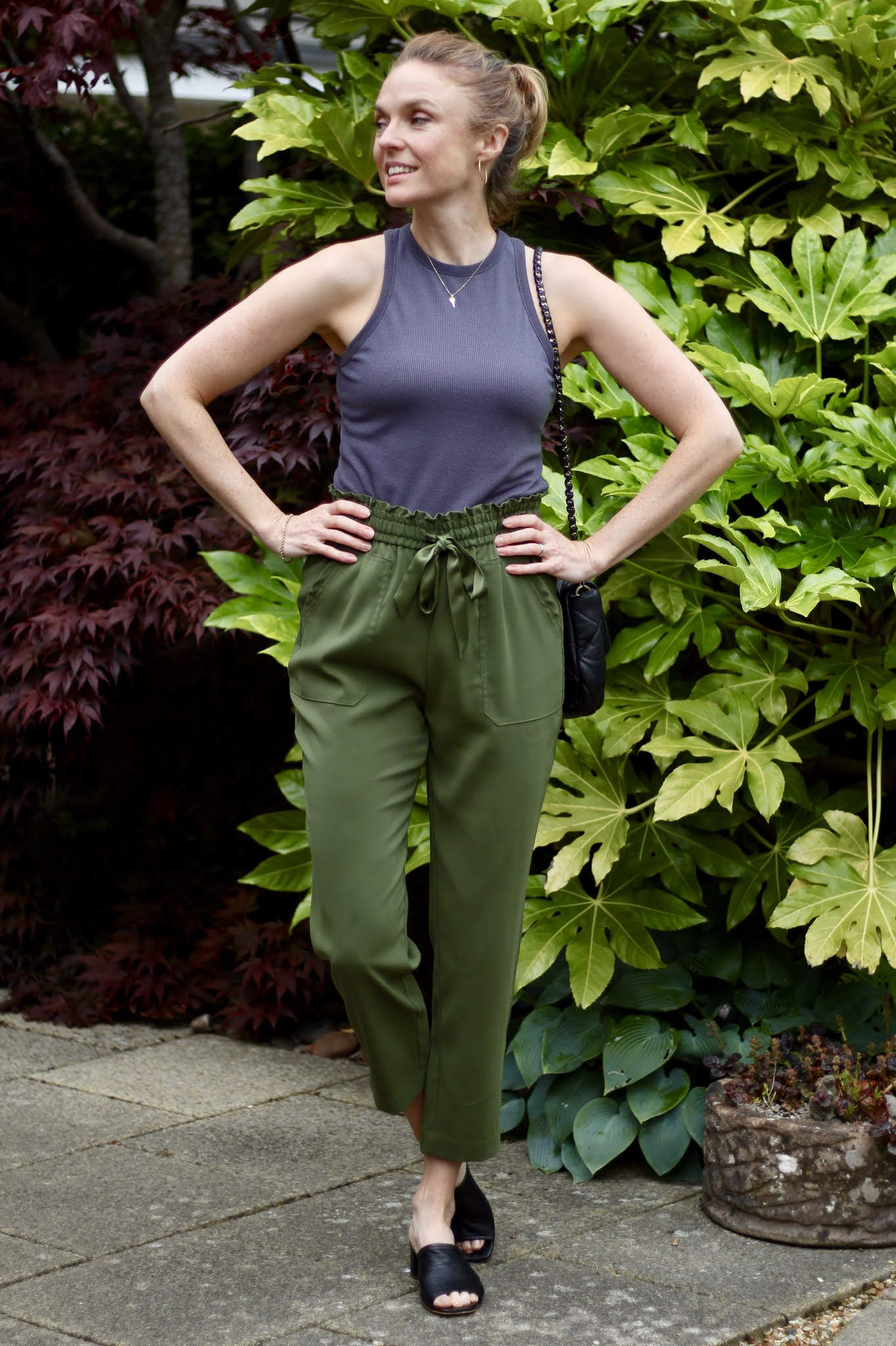 Grey tank, green joggers, black mules • Fake Fabulous