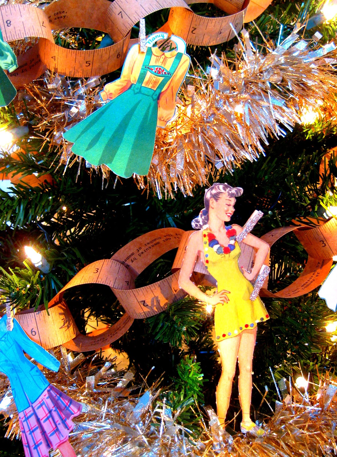 This tree has everything I want for Christmas on it: gorgeous vintage  dresses!