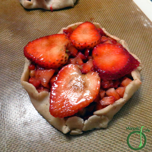 Morsels of Life - Balsamic Strawberry Galette Step 3 - Place strawberries in the center of each piece of dough and fold the edges over. Repeat for each galette you make. Bake at 400F for about 45 minutes.