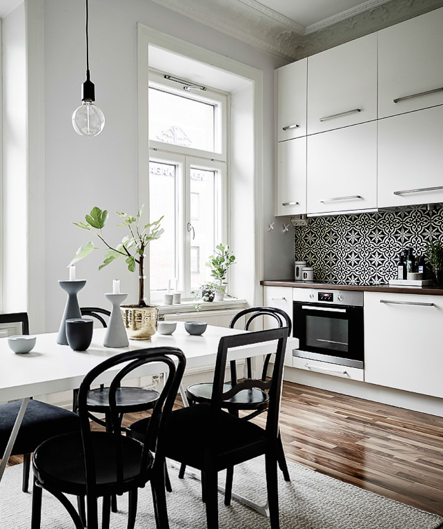 white kitchen with patterned tiles