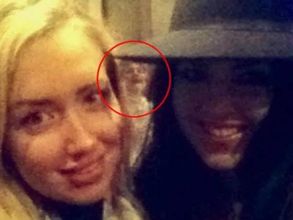 The appearance of a ghost of a laughing woman was accidentally caught in the selfie of these two women