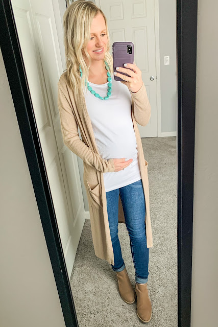Neutral maternity outfit with a pop of turquoise