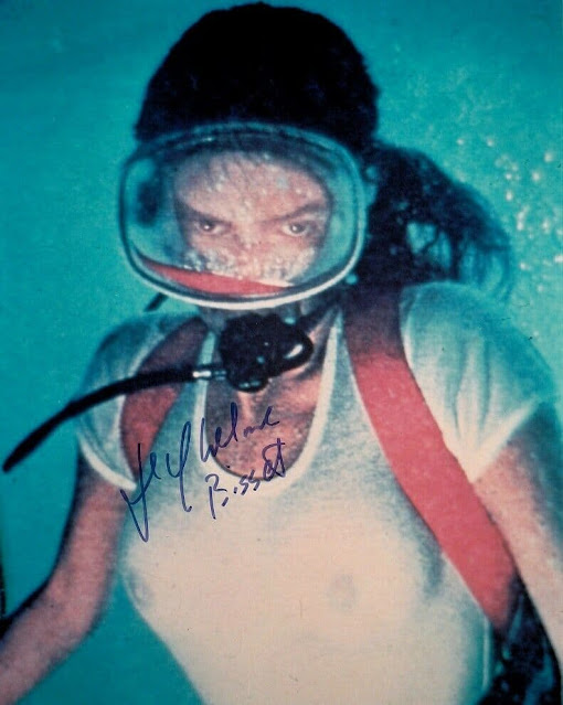 The autographed photo of Jacqueline Bisset diving the Rhone
