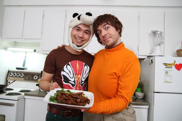 Ben Liu with Mathieu Pichette, holding Pattes de Poule by Benda, panda cooking, cuisine de Chine, Radio Canada, Le Monde en Gros, Ben Liu art