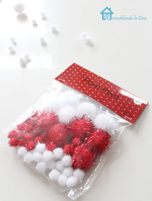 A packgage of 50 red and white pom poms