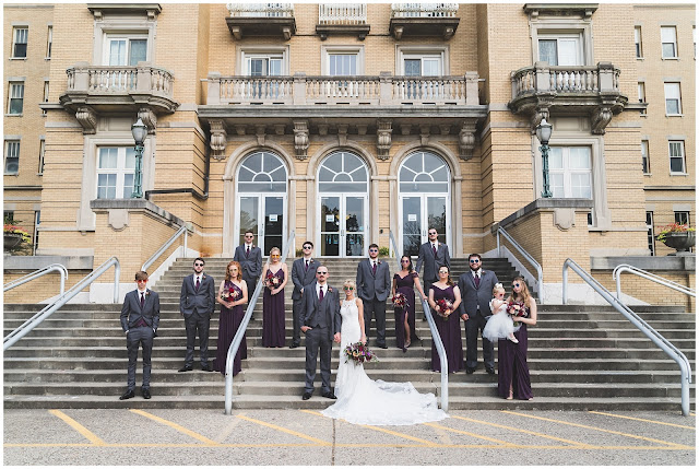 photo of wedding party on steps