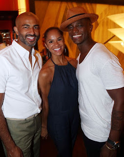 Picture of Misty Copeland with her hubby Olu Evans and Taye Diggs