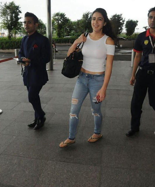 Bollywood Actress Sara Ali Khan Spotted At Airport in Jeans and White Top Navel Queens